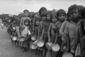 image of Cambodian refugee children, wait for food at aid station outside of Phnom Penh. (AP Photo/Tea Kim Heang aka Moonface)