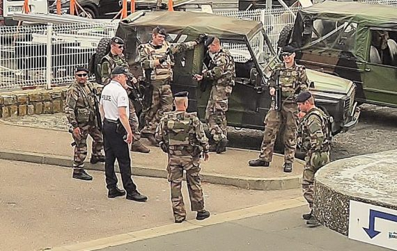 image of French security waiting in the background