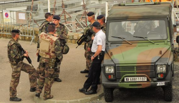 image of French security wait in the background