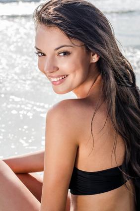 Image of Beautiful girl at seaside smiling