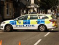 image of a police car positioned across a busy road