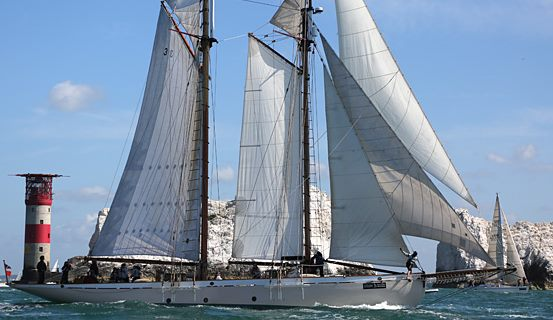Classic two masted Ketch nears the Needles Rocks and lighthouse.