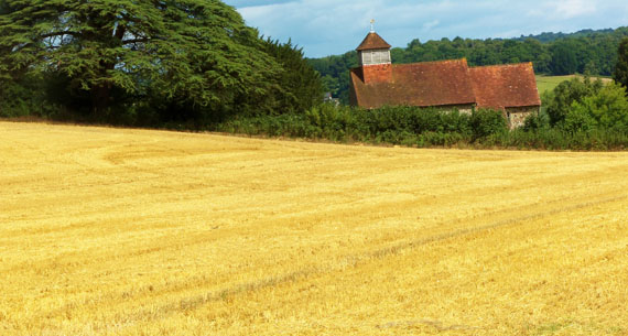 Picture of church and straw field
