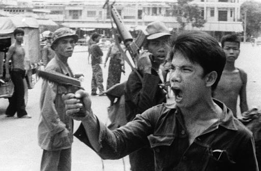 image of Racial hatred? Sophie's uncle was nine years old when they shot him. Vietnam 1975 Khmer Rouge Soldiers (AP Photo/Christoph Froehder)